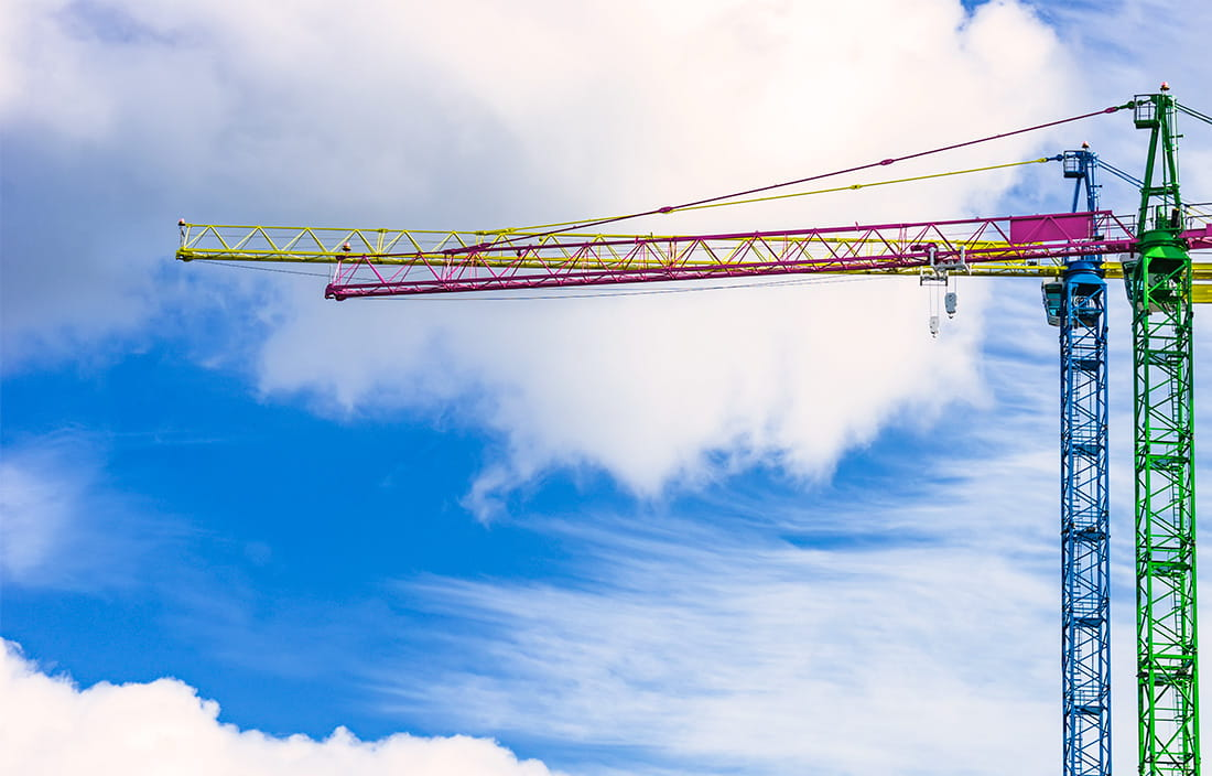 Image of building cranes against the sky