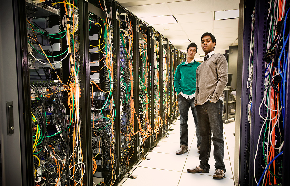 Image of people standing in a server room