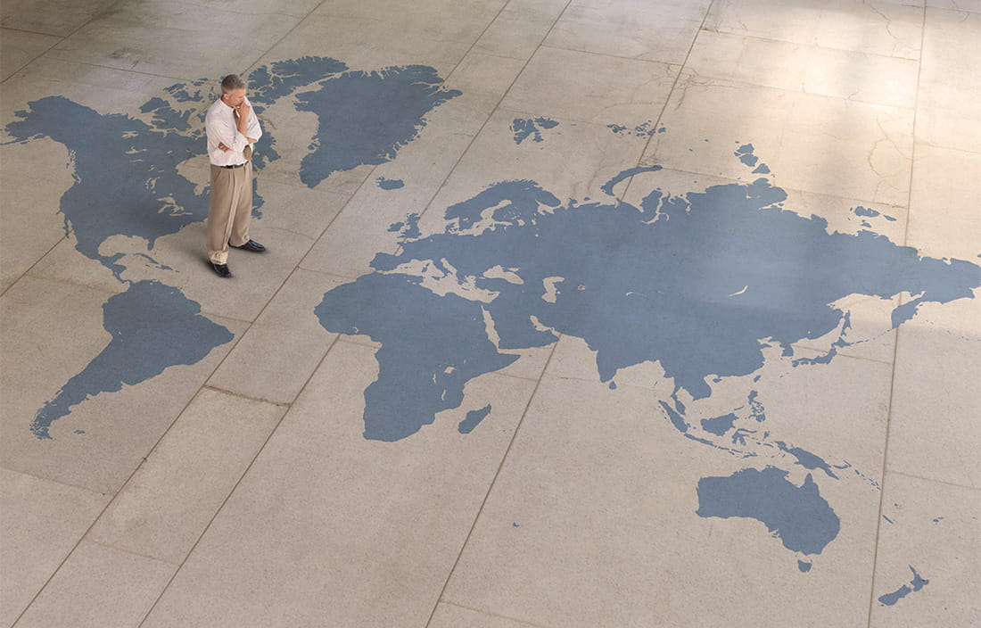 Image of man standing of large flat map
