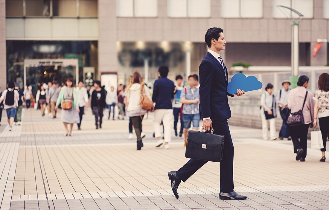 Image of a business man walking outside