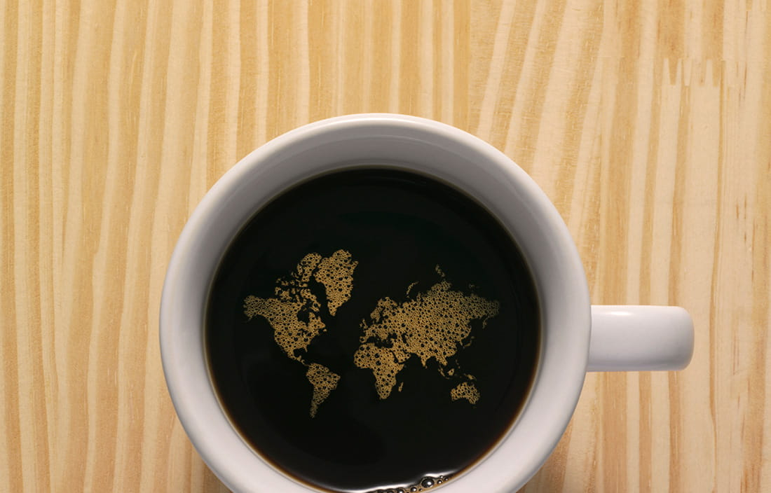 Image of coffee cup with map inside