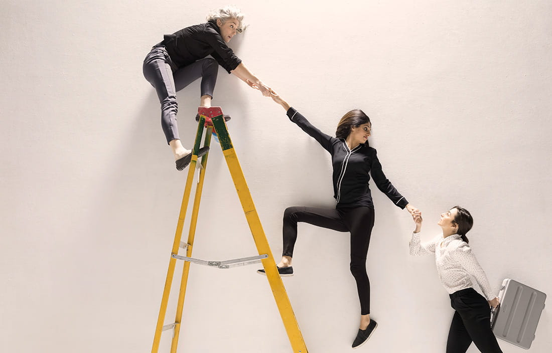 Image of women on ladder