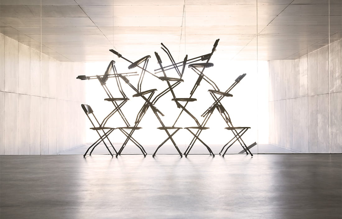 Image of chairs stacked on top of each other