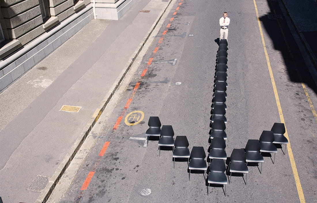 image of chairs arranged as an arrow