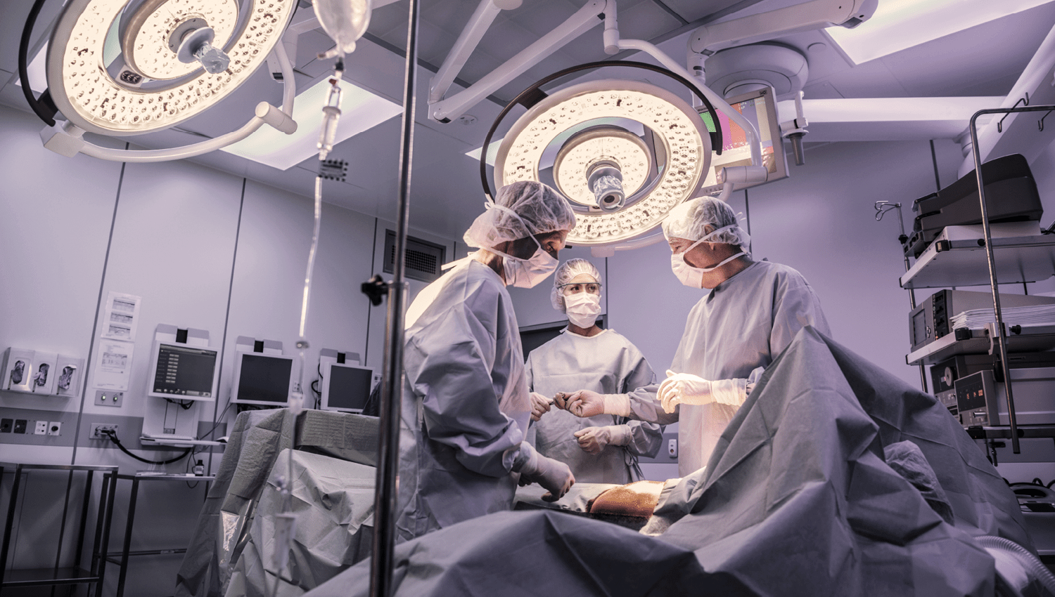 Image of surgical personnel performing an operating in an operating room.