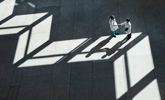 Image of two doctors in a hallway
