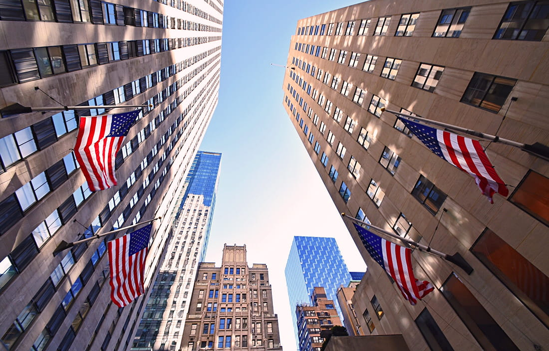 Image of corporate buildings with American flags