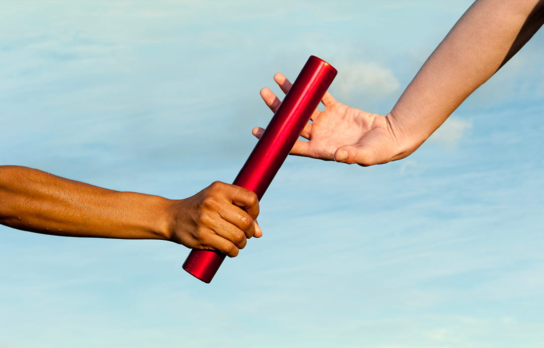 People passing a baton