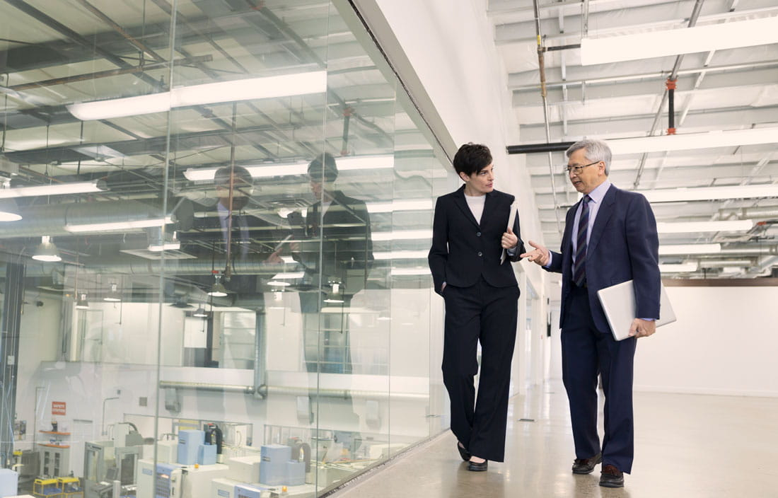 Image of two business people walking