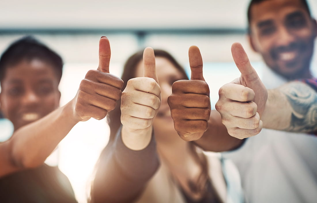 Image of business people giving thumbs up