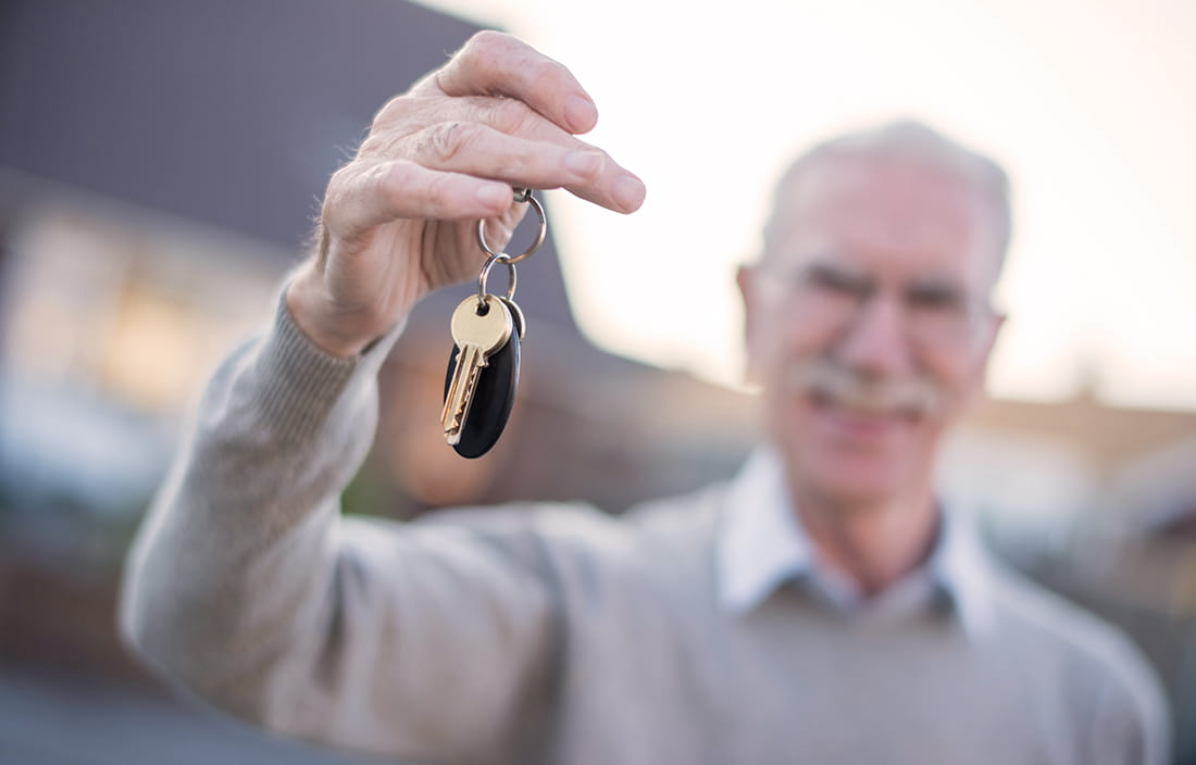 Image of elderly man holding keys.