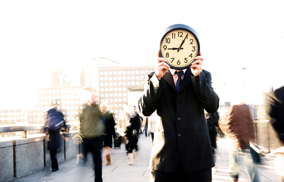 Images of man with clock in front of his face