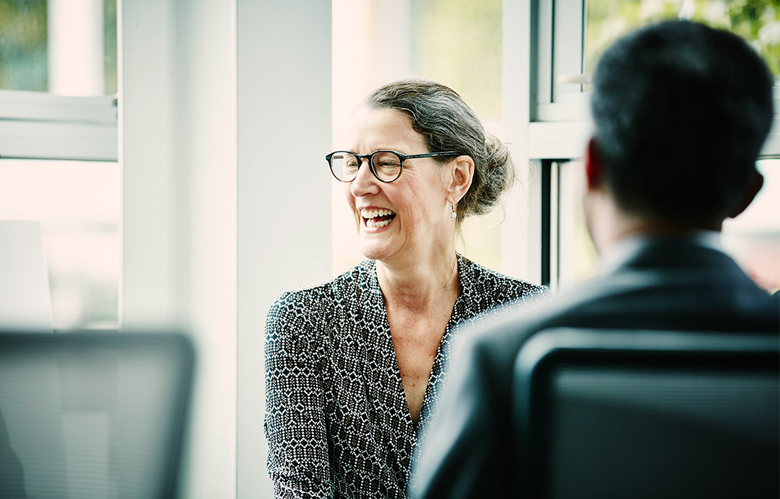 Woman laughing with advisor