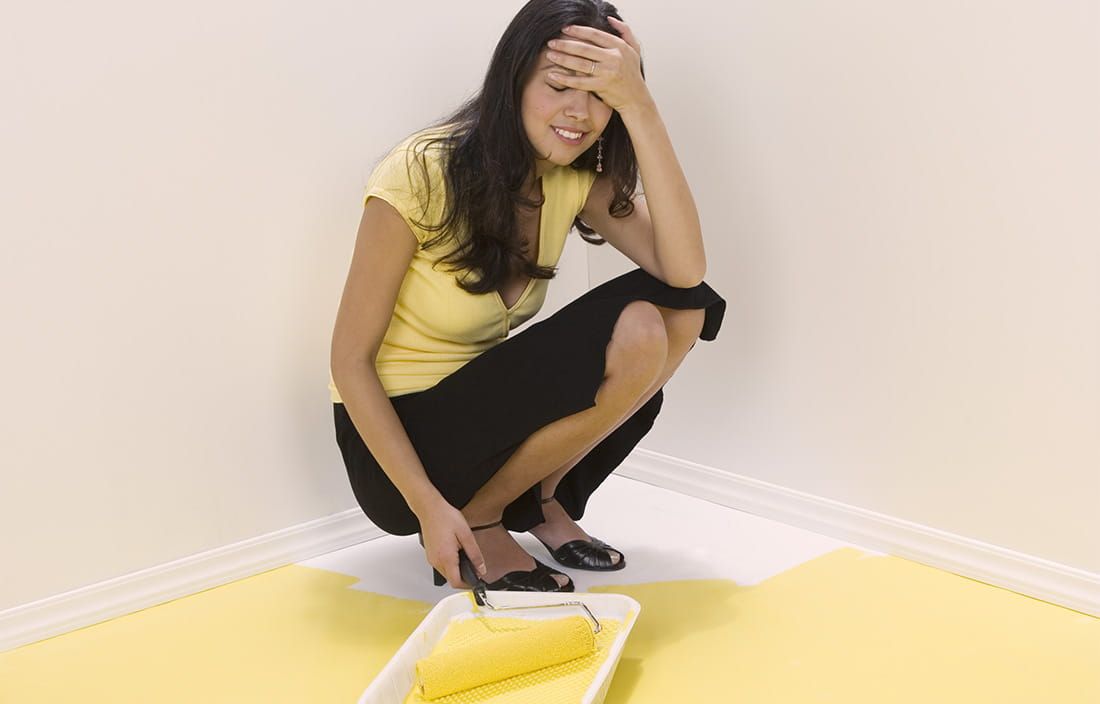 Image of woman painter herself into a corner