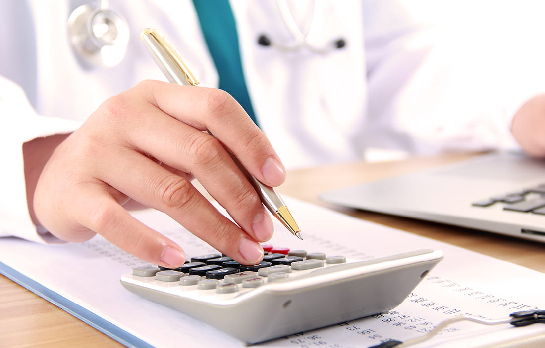 Doctor working on hospital expenditures