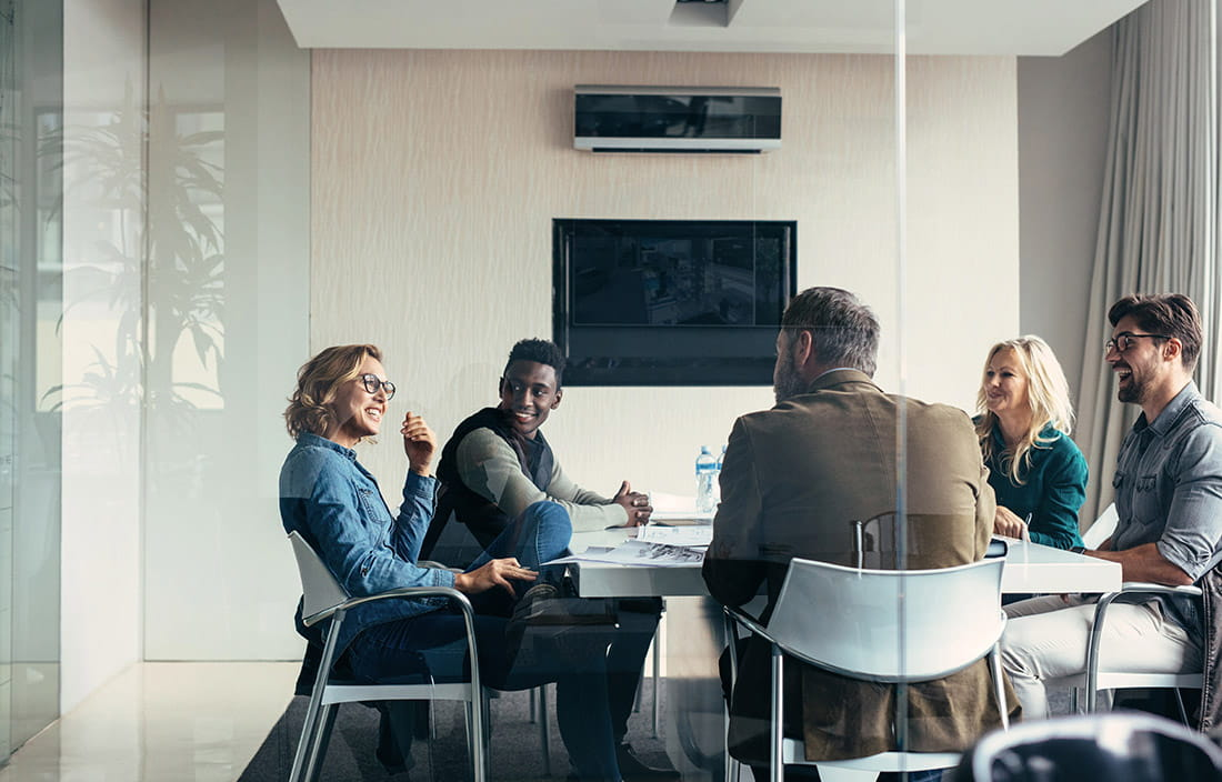 Group of people in a glass meeting room