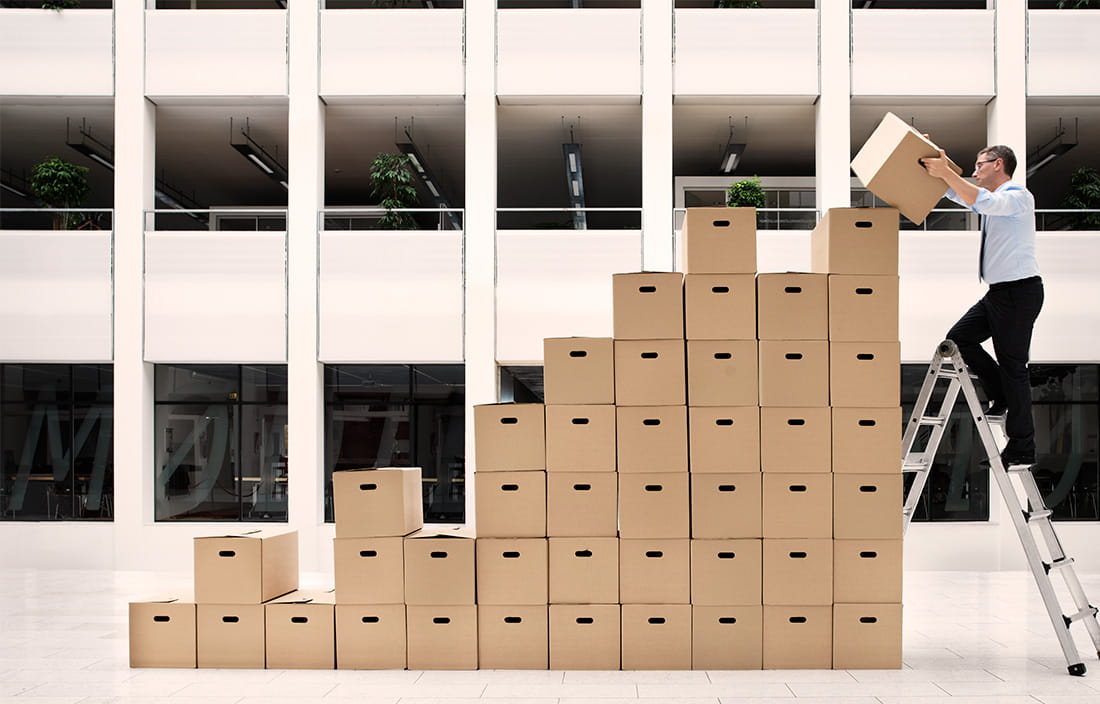 Image of man stacking boxes