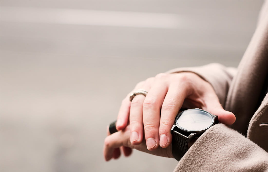 Photo of man checking watch