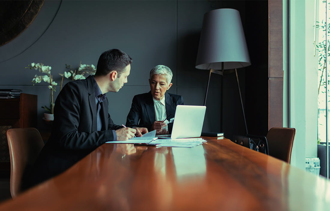 Image of men working in conference room