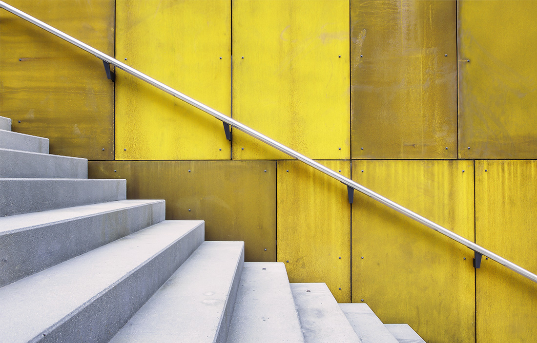 Image of white stairs against yellow wall