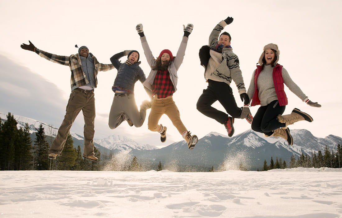 Image of people jumping in snow