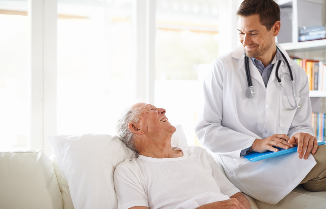 Elderly male senior citizen talking with a doctor.