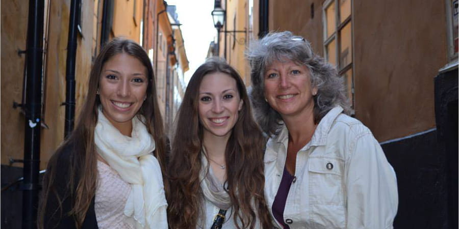 Sue Novak and her two daughters in Sweden.