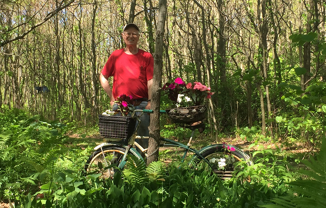 Glen Poole with bike in forest