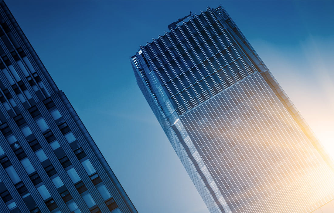 Image of skyscraper with reflection of sun