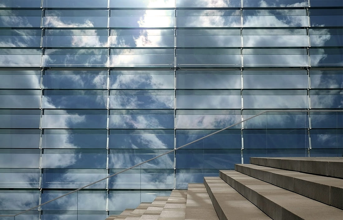 Stairs with reflection of buildings