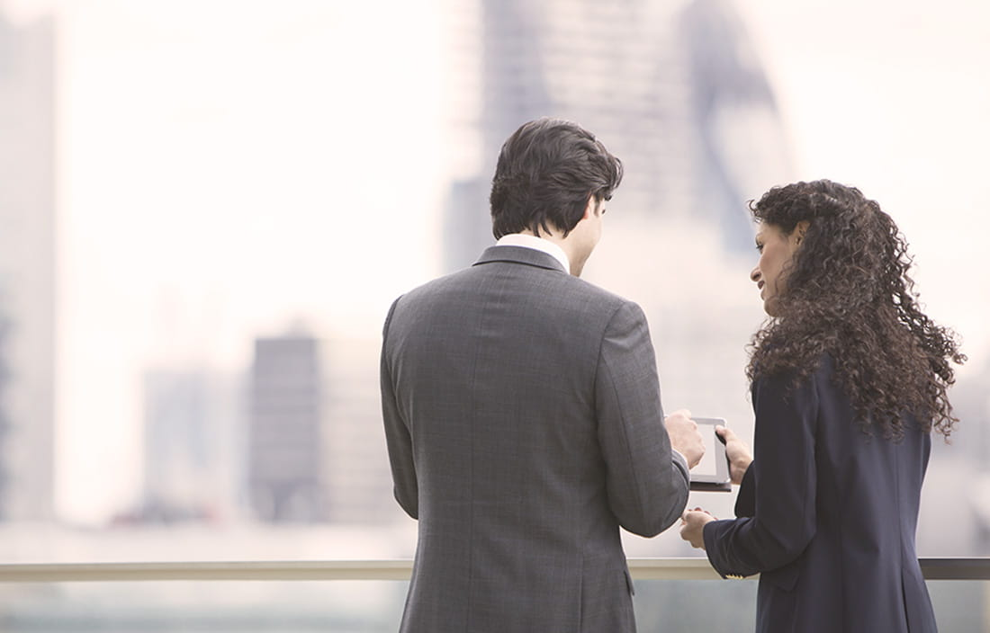 Business partners overlooking a blurred cityscape