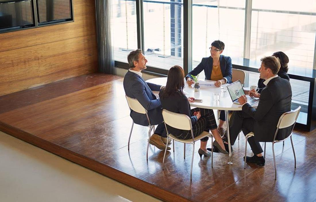 Team members having a meeting at a table