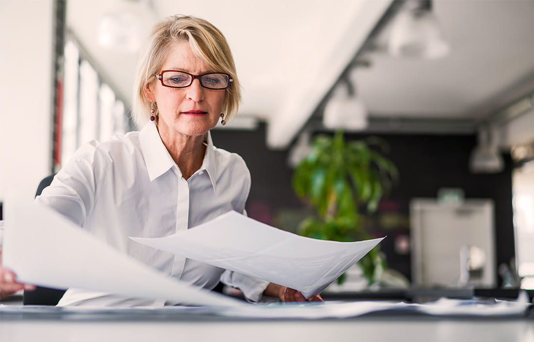 Business woman working with papers