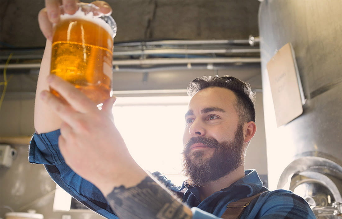 Man looking at draft beer