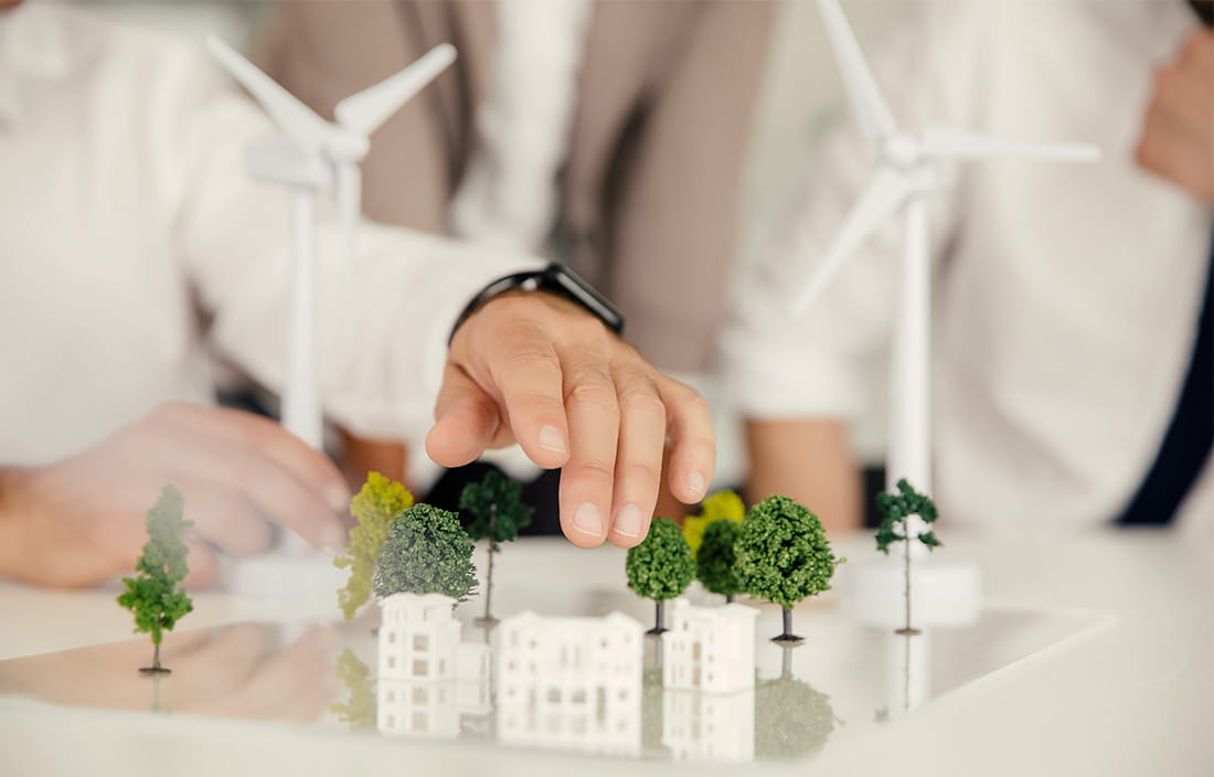 miniature model of a few buildings and trees