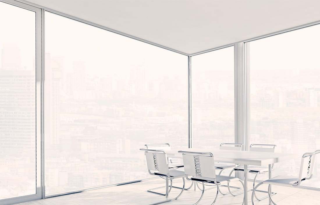 modern corner office board room with windows floor to ceiling
