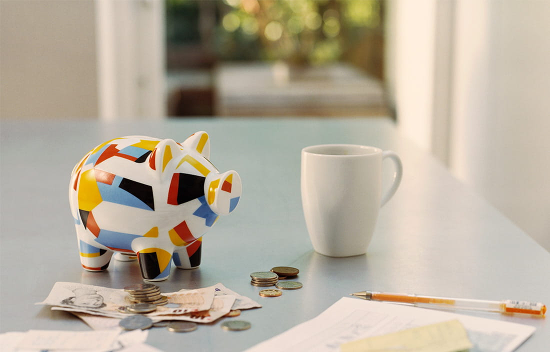 desk with multicolored art decco piggy bank