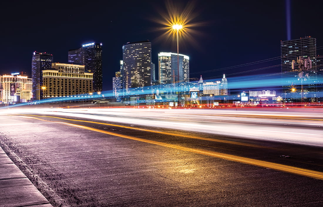 Image of Las Vegas Strip with blurred motion lines from passing cars.