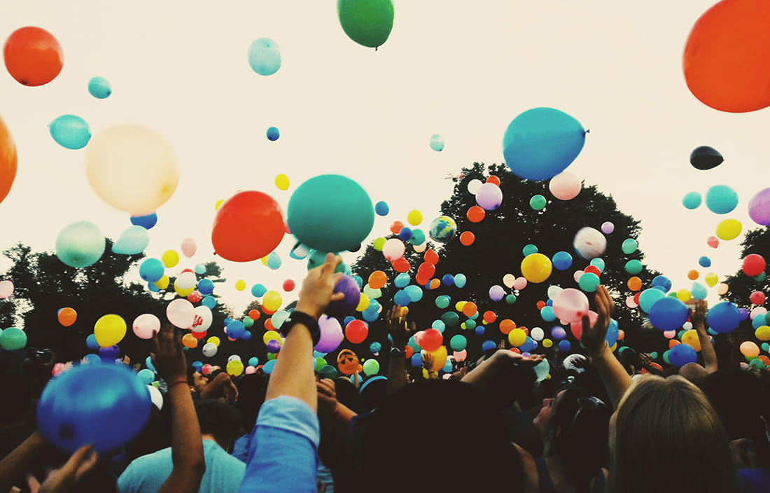 Image of people celebrating with balloons