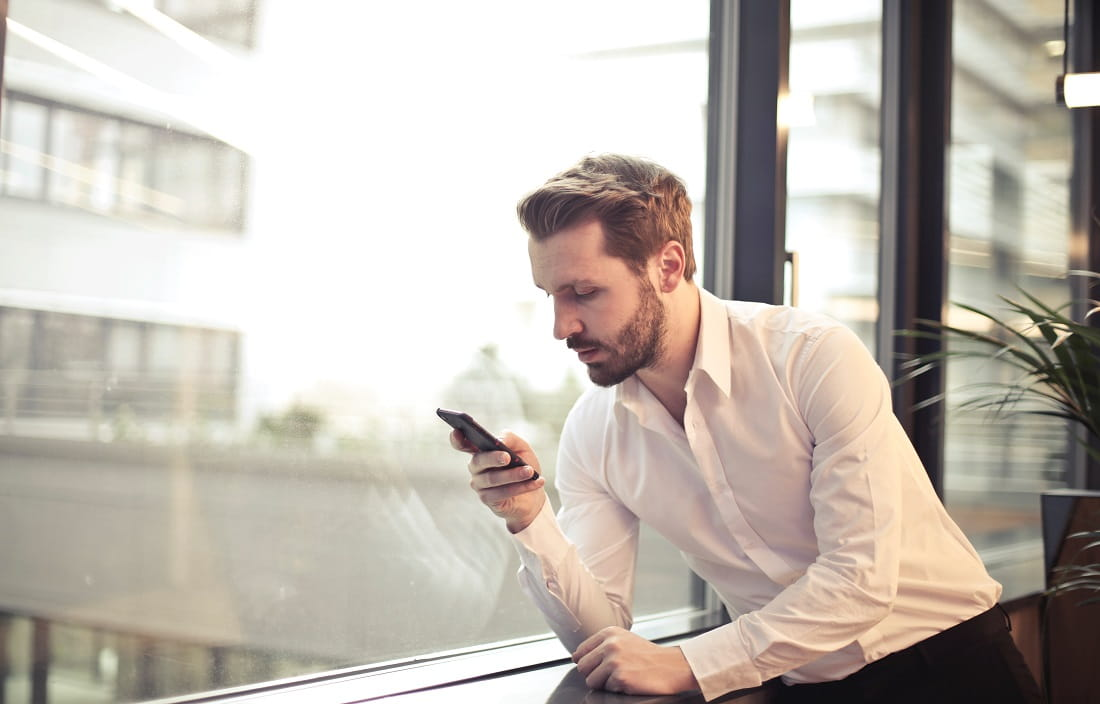 Image of man on phone at window