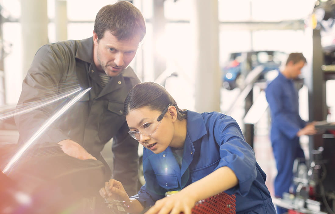 Image of man and woman working in manufacturing plant