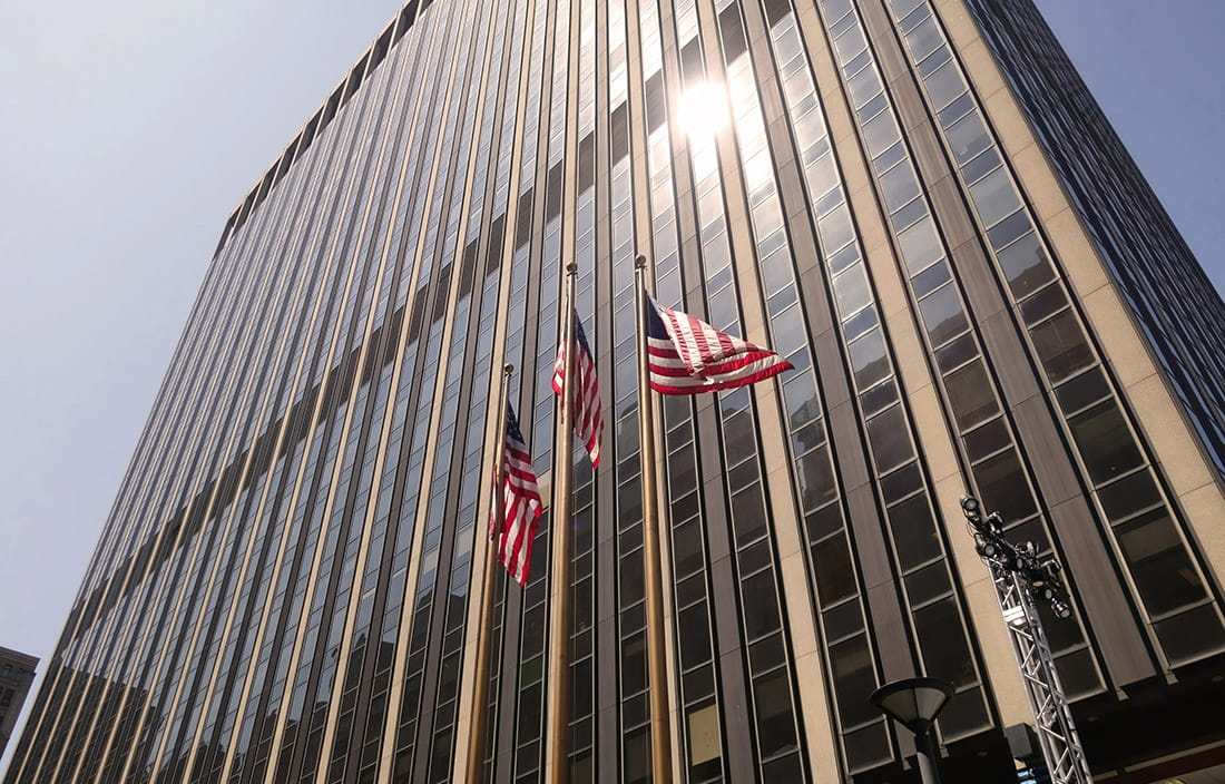 A building with American flags in front of it.