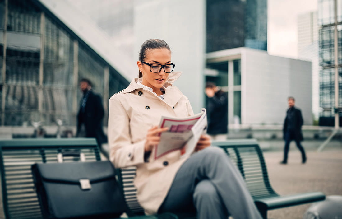 Woman reading a magazine about service audits