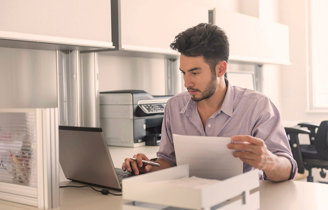 Man looking over accounting documents