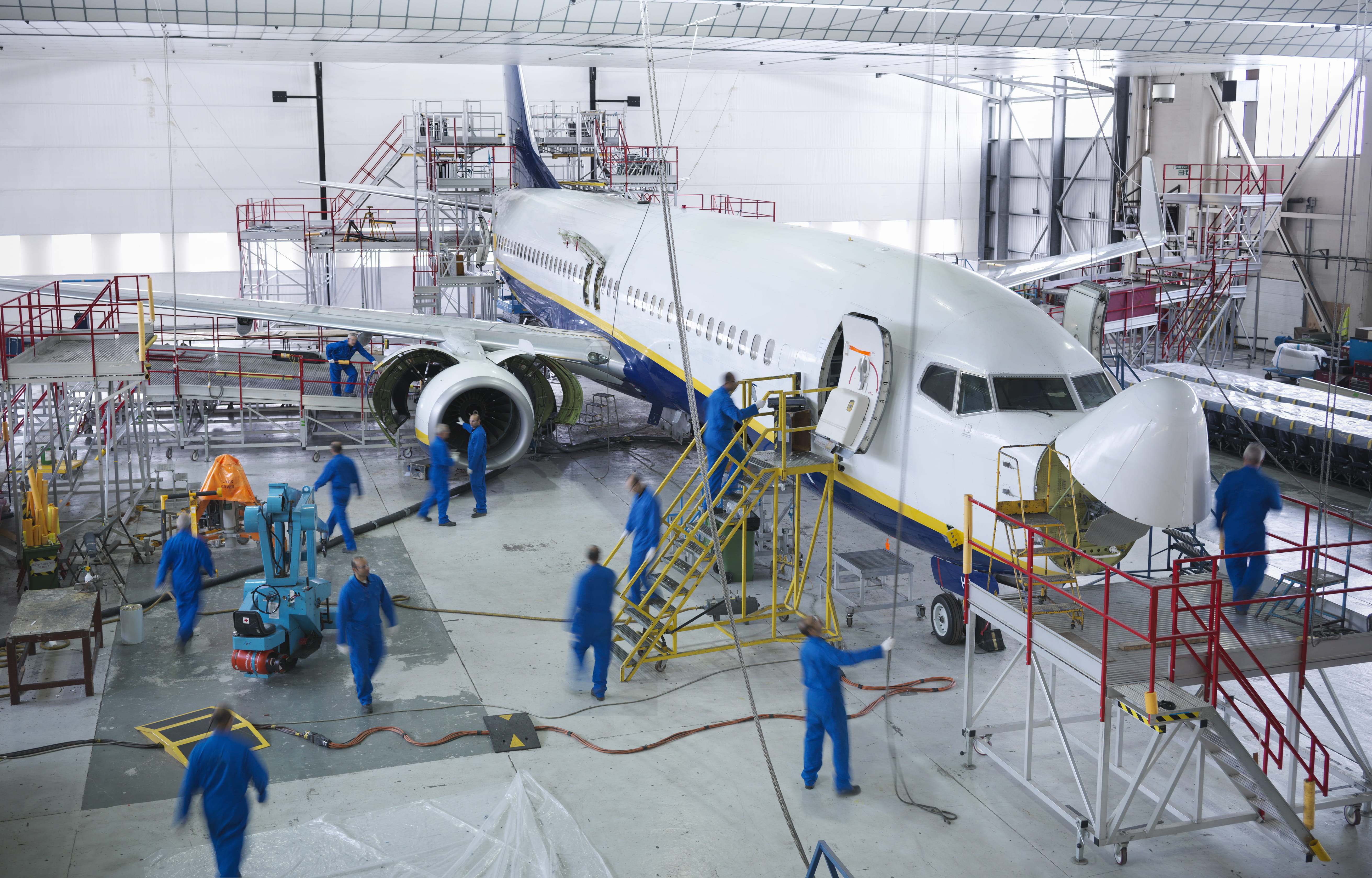Image of engineers working on airplane.