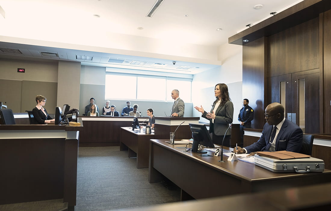 Image of a courtroom in session.