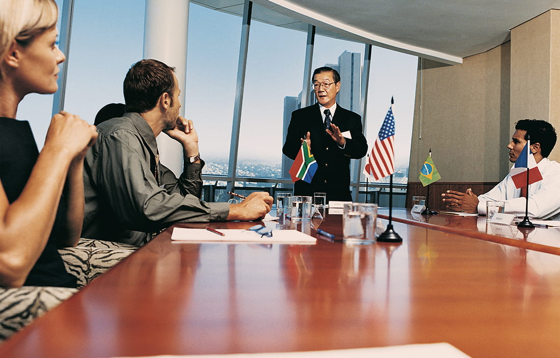 International meeting with country flags on conference room table