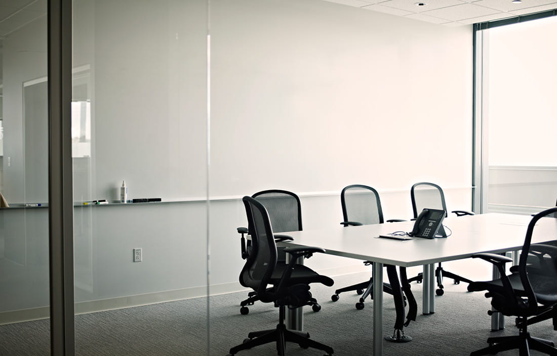 Empty meeting room with a table and chairs