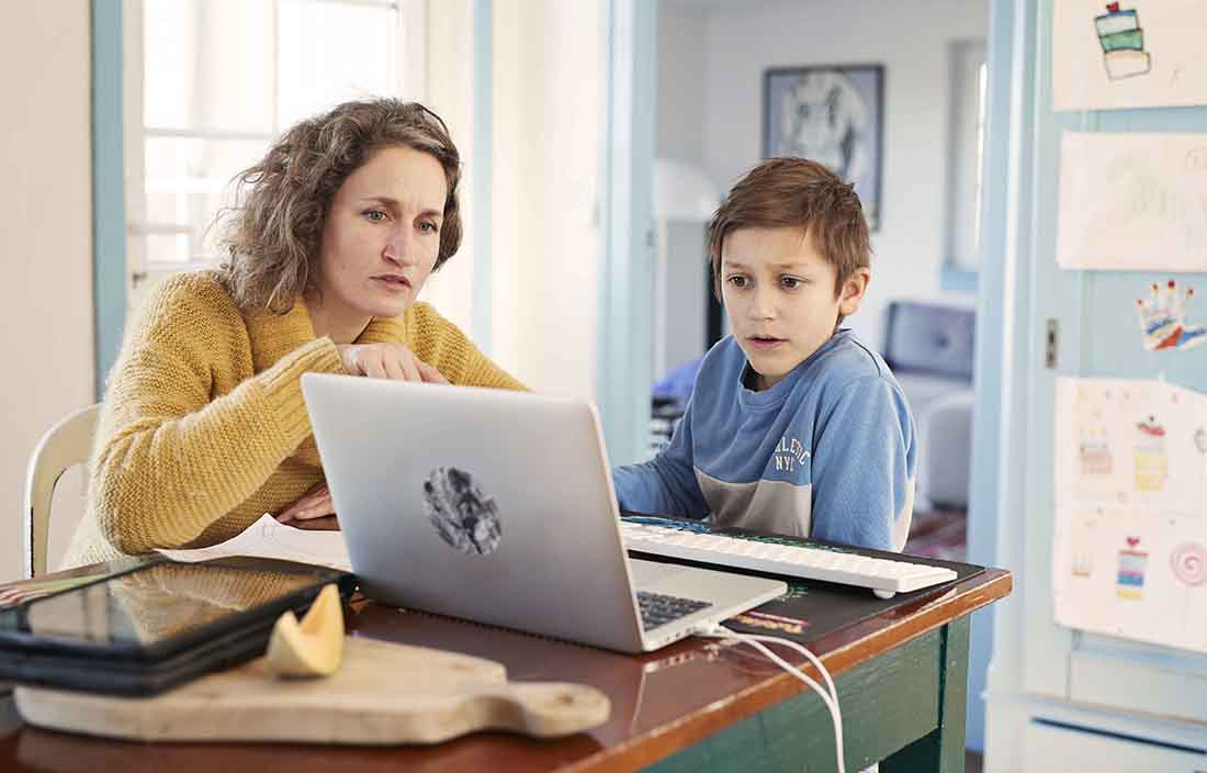 Mother and son looking at a laptop