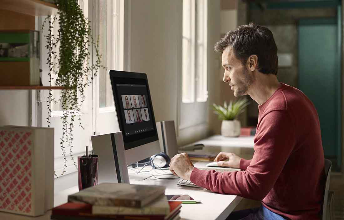 Man working from home a virtual office environment.